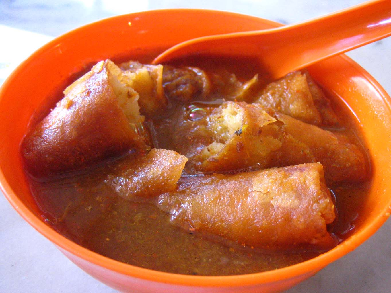 Fried popiah in laksa soup